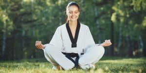 Martial Arts Lessons for Adults in Maplewood NJ - Happy Woman Meditated Sitting Background
